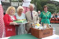 Prince Charles being presented with a hamper of local produce